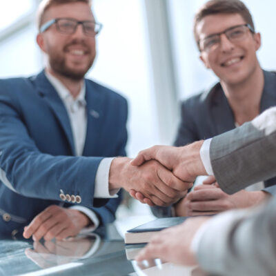 close up. successful business people shaking hands . concept of cooperation
